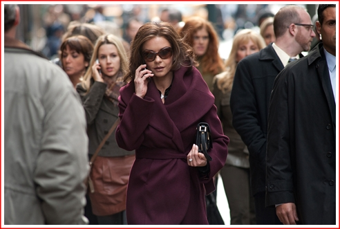 That's Tal as the gal-friday on the cell phone tracking Zeta-Jones also on the cell phone
