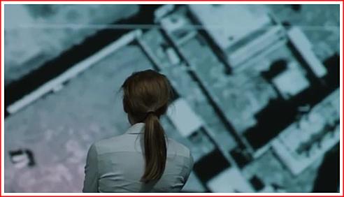 Maya studies the satellite images