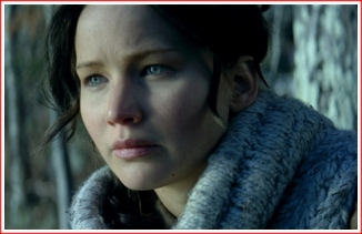 Opening: Katniss sits in the forest waiting for something to kill for dinner, and pondering her situation