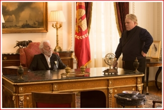 President Snow and GamesMaster Plutarch Heavensbee discuss the Katniss 'problem'