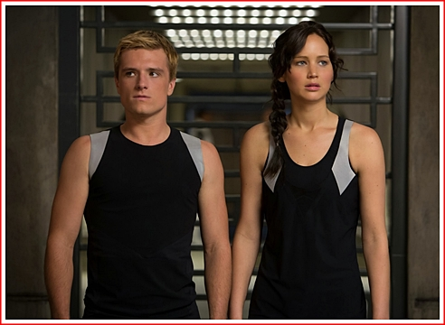 Katniss and Peeta in training. She's taller than he is.