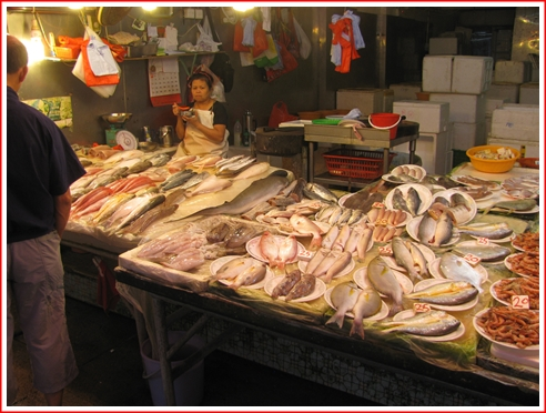 A fish stall in the wet aisle on the right