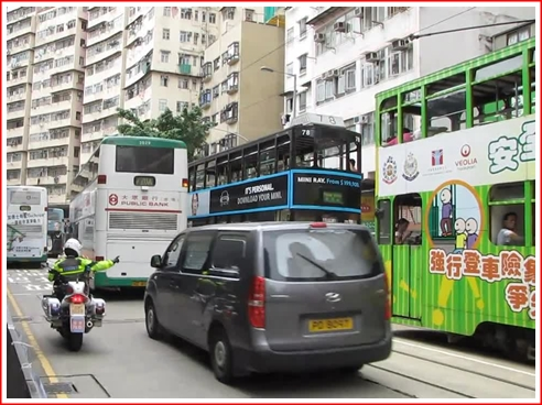 Even in Shau Kei Wan, the traffic cops bust drivers and ask them to pull over
