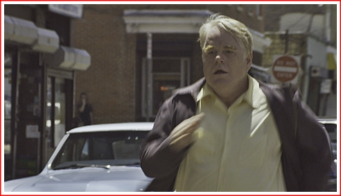 Hoffman as Mickey Scarpato in pursuit of the deceased Leon Scarpato in God's Pocket