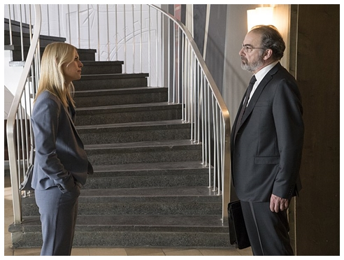 No one smiles in this face to face crossing of paths between Carrie and Saul